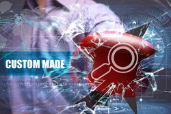 Business, Technology, Internet and network concept. Young businessman breaks the virtual future of the screen on which the inscription: custom made