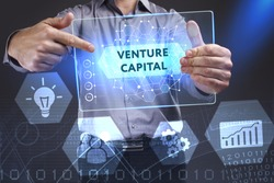 Business, Technology, Internet and network concept. Young businessman showing a word in a virtual tablet of the future: Venture capital