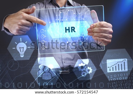 Business, Technology, Internet and network concept. Young businessman showing a word in a virtual tablet of the future: HR