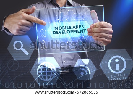 Business, Technology, Internet and network concept. Young businessman showing a word in a virtual tablet of the future: Mobile apps development #572886535