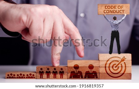 Business, Technology, Internet and network concept. Young businessman shows the word:Code of conduct  Сток-фото ©