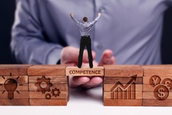 Business, Technology, Internet and network concept. Young businessman shows the word:Competence