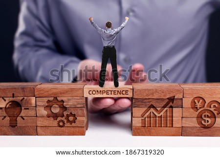 Business, Technology, Internet and network concept. Young businessman shows the word:Competence Stock photo ©