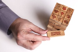 Business, Technology, Internet and network concept. Young businessman shows the word: Internal control