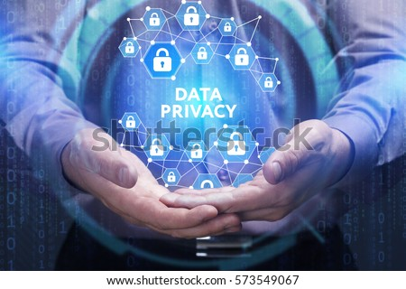 Business, Technology, Internet and network concept. Young businessman shows the word on the virtual display of the future: Data privacy #573549067