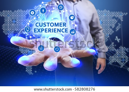 Business, Technology, Internet and network concept. Young businessman shows the word on the virtual display of the future: Customer experience