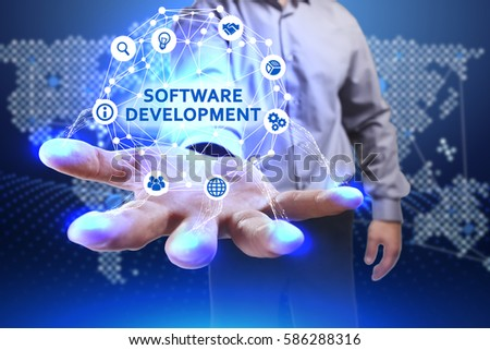Business, Technology, Internet and network concept. Young businessman shows the word on the virtual display of the future: Software development