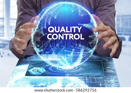 Business, Technology, Internet and network concept. Young businessman shows the word on the virtual display of the future: Quality control