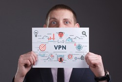Business, technology, internet and network concept. Young businessman thinks over the steps for successful growth: VPN