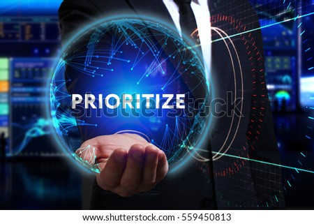 Business, Technology, Internet and network concept. Young businessman working in the field of the future, he sees the inscription: prioritize