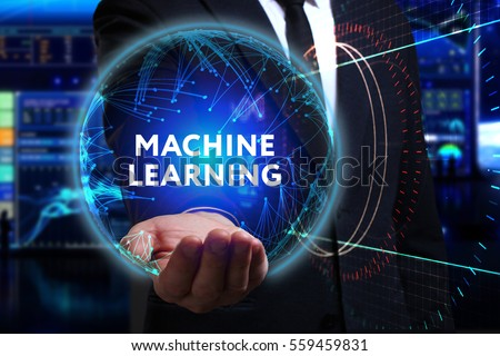 Business, Technology, Internet and network concept. Young businessman working in the field of the future, he sees the inscription: machine learning  #559459831