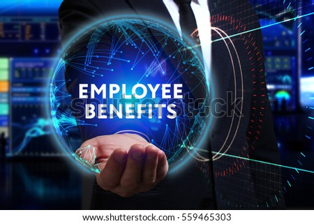 Business, Technology, Internet and network concept. Young businessman working in the field of the future, he sees the inscription: employee benefits  #559465303
