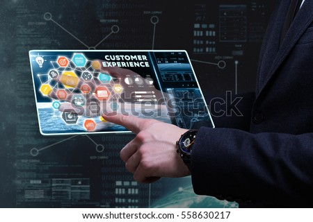 Business, Technology, Internet and network concept. Young businessman working on a tablet of the future, he sees the inscription: customer experience