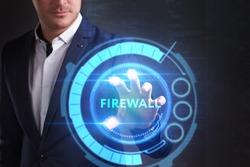 Business, Technology, Internet and network concept. Young businessman working on a virtual screen of the future and sees the inscription: Firewall