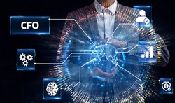 Business, Technology, Internet and network concept. Young businessman working on a virtual screen of the future and sees the inscription: CFO