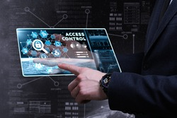 Business, Technology, Internet and network concept. Young businessman working on a virtual screen of the future and sees the inscription: access control