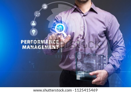 Business, Technology, Internet and network concept. Young businessman working on a virtual screen of the future and sees the inscription: Performance management #1125415469