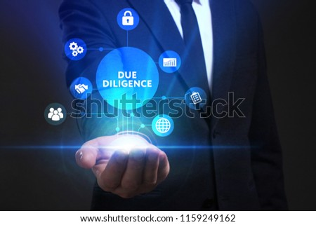 Business, Technology, Internet and network concept. Young businessman working on a virtual screen of the future and sees the inscription: Due diligence Foto stock ©