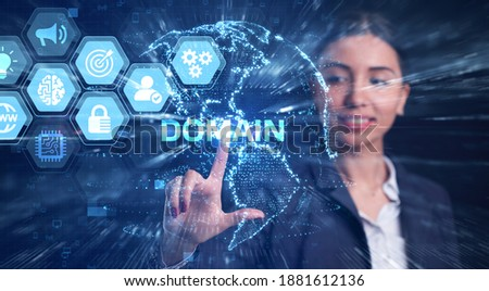 Business, Technology, Internet and network concept. Young businessman working on a virtual screen of the future and sees the inscription: Domain Foto stock ©