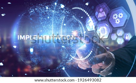 Business, Technology, Internet and network concept. Young businessman working on a virtual screen of the future and sees the inscription: Implementation Сток-фото ©