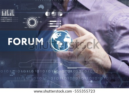 Business, Technology, Internet and network concept. Young businessman working on a virtual screen of the future and sees the inscription: forum