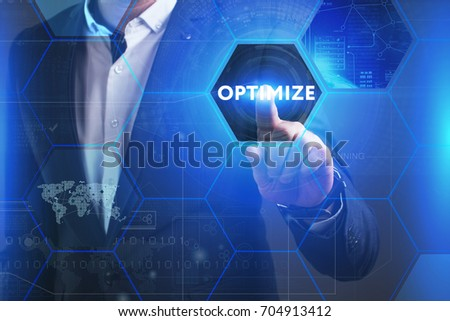 Business, Technology, Internet and network concept. Young businessman working on a virtual screen of the future and sees the inscription: Optimize #704913412