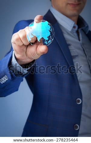 business, technology, internet and networking concept - businessman pressing make money button on virtual screens