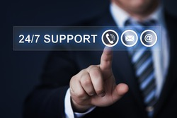 business, technology, internet and networking concept - businessman pressing 24/7 support button on virtual screens