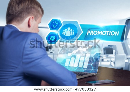 Business, technology, internet and networking concept. Young businessman working on his laptop in the office, select the icon promotion on the virtual display.