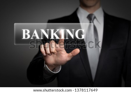 business, technology, internet, network concept - businessman in suit presses virtual touchscreen button - english word BANKING #1378117649