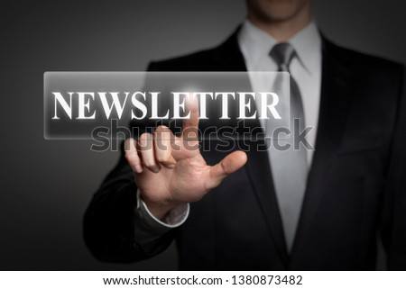 business, technology, internet, network concept - businessman in suit presses virtual touchscreen button - english word NEWSLETTER #1380873482