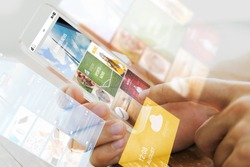 business, technology, mass media and people concept - close up of male hand holding transparent smartphone with internet news web page on screen