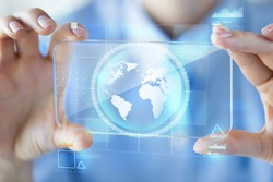business, technology, mass media and people concept - close up of woman hand holding and showing transparent with earth globe on screen smartphone at office