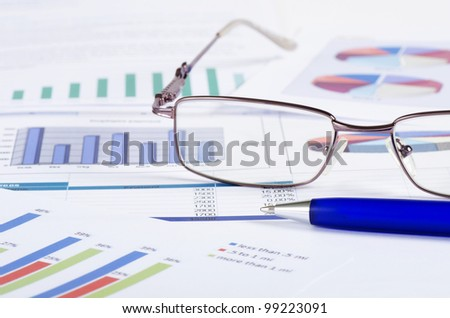 Business the newspaper with chart