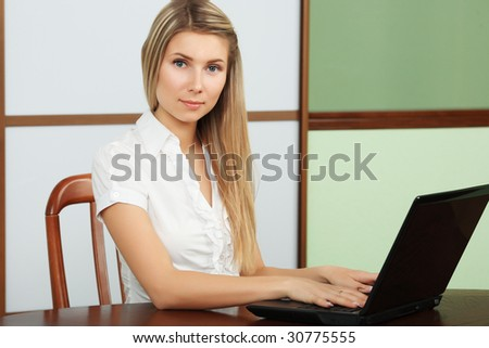 Business theme: beautiful businesswoman in a work process.