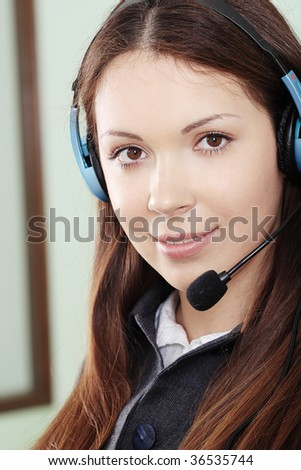 Business theme: beautiful operator in a work process in office. - stock photo