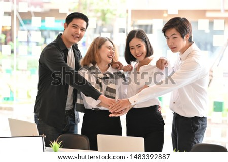 Business together, Four young business people confidently and motivation relax in modern office. #1483392887