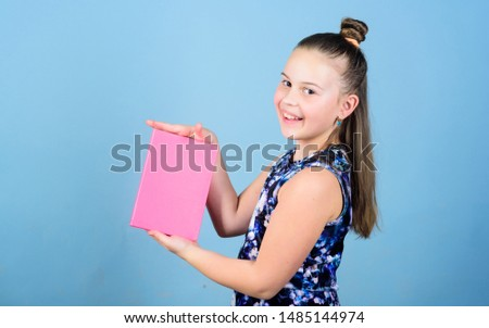 business trainer. showing book cover. publishing business. workbooks for writing. school diaries for making notes. small girl with pink note book. school child with notepad. presenting product. #1485144974