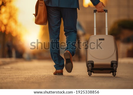 Business traveler pulling suitcase on airport.Business travel. Photo stock ©