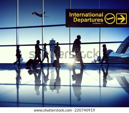 Business Travellers At Airport