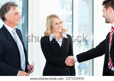 Business - Two businesspeople shaking hands