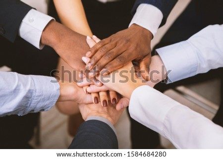 Business unity. Multiethnic corporate teame stacking hands together in office, close up #1584684280