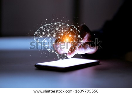 Business using smartphone,with brain icon,creativity and innovative are keys to success,new ideas and innovation concept.