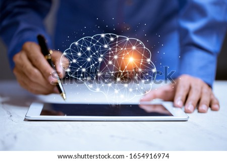 Business using tablet,with brain icon,creativity and innovative are keys to success,new ideas and innovation concept.