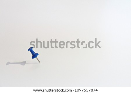 Business vision, mission, target or goal concept : Blue thumbtack on white background with copy space ready for adding or mock up - Shutterstock ID 1097557874