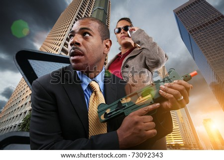 Business war game concept. Businesspeople armed with gun in city.