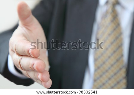 Business welcome. Closeup of businessman ready to give handshake , open gesture