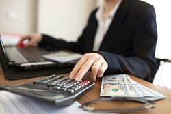 business woman accountant or banker making calculation. Savings, finance and economy control debt concept.