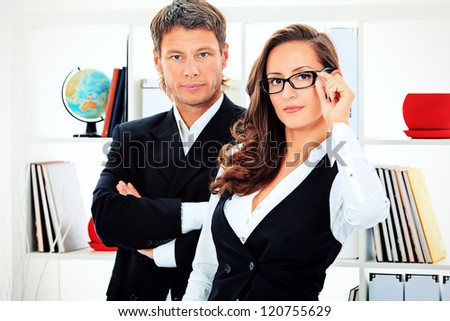 Business woman and businessman working together at the office.