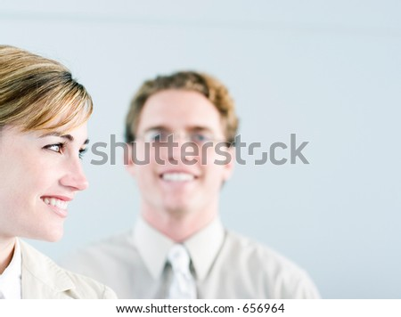 business woman and man standing together